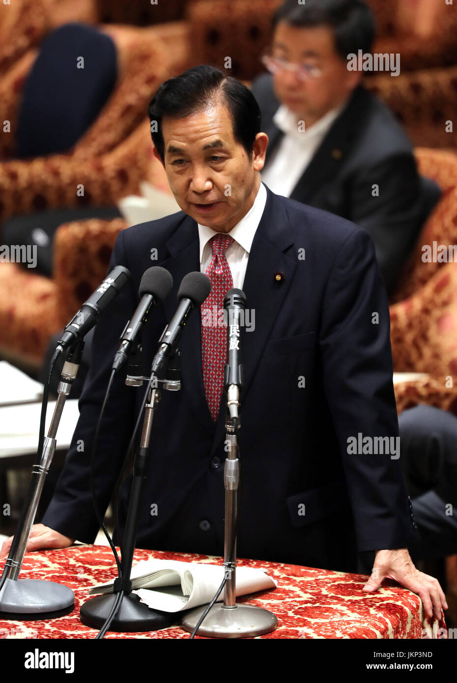 Tokyo, Japan. 24th July, 2017. Japanese Regional Revitalization Minister Kozo Yamamoto answers a question to an - Stock Image