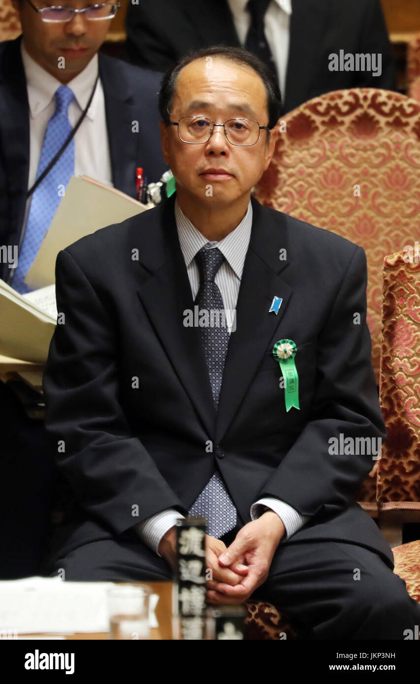 Tokyo, Japan. 24th July, 2017. Hiroto Izumi, a special advisor to Japanese Prime Minister Shinzo Abe listens to - Stock Image