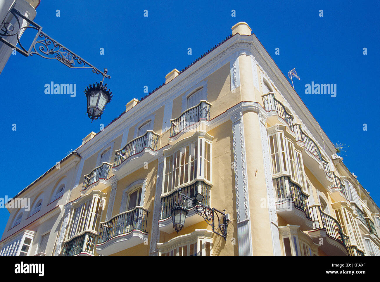 Facade of house, view from below. Ancha street, Cadiz, Spain. - Stock Image