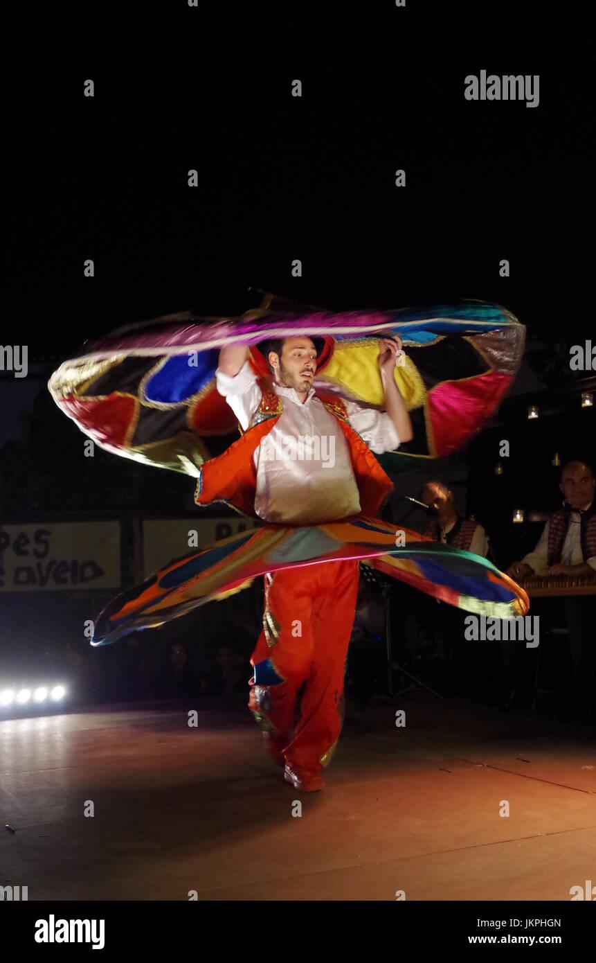 Sufi Dancer performing at Mercado das Culturas à luz das Velas festival in Lagoa, Algarve, Portugal. Travel and Stock Photo