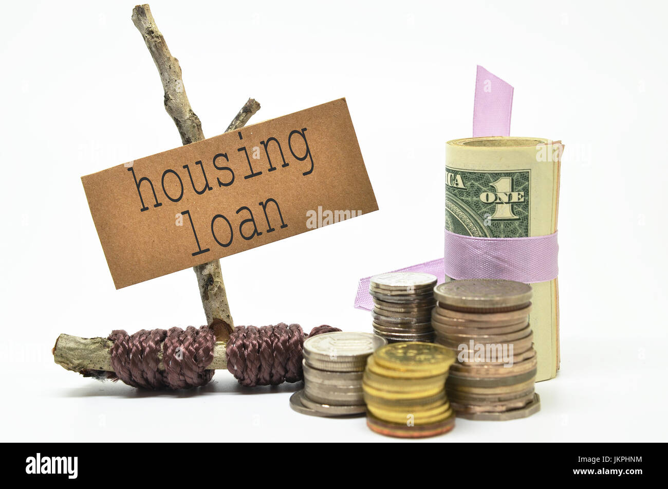Coins and money with  housing loan label. Financial concept. Stock Photo