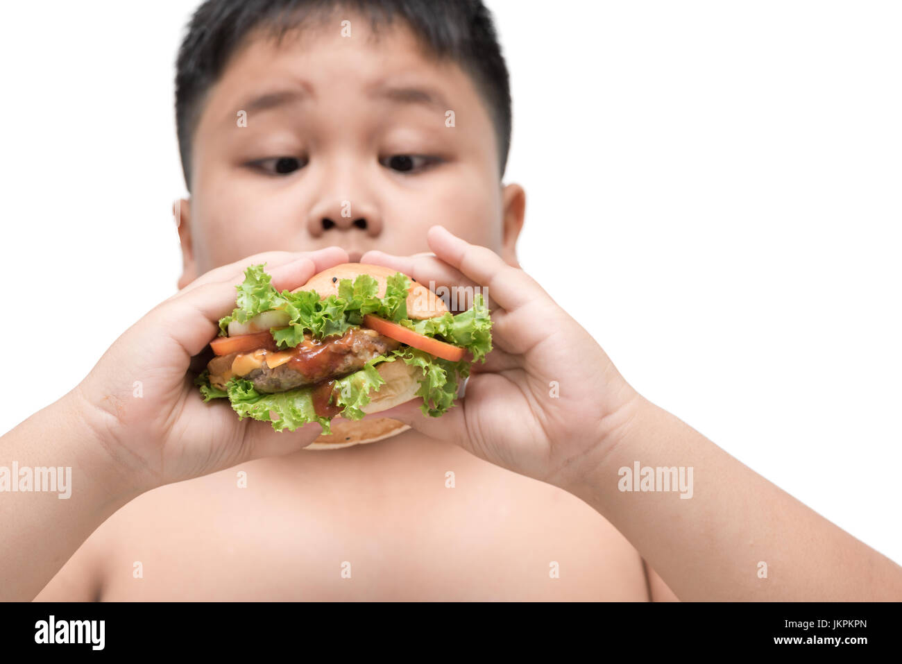 pork hamburger on obese fat boy hand background isolated on white, unhealthy food, junk food or fast food - Stock Image