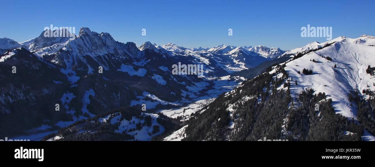 Snow covered mountains, winter scene in Switzerland. Stock Photo