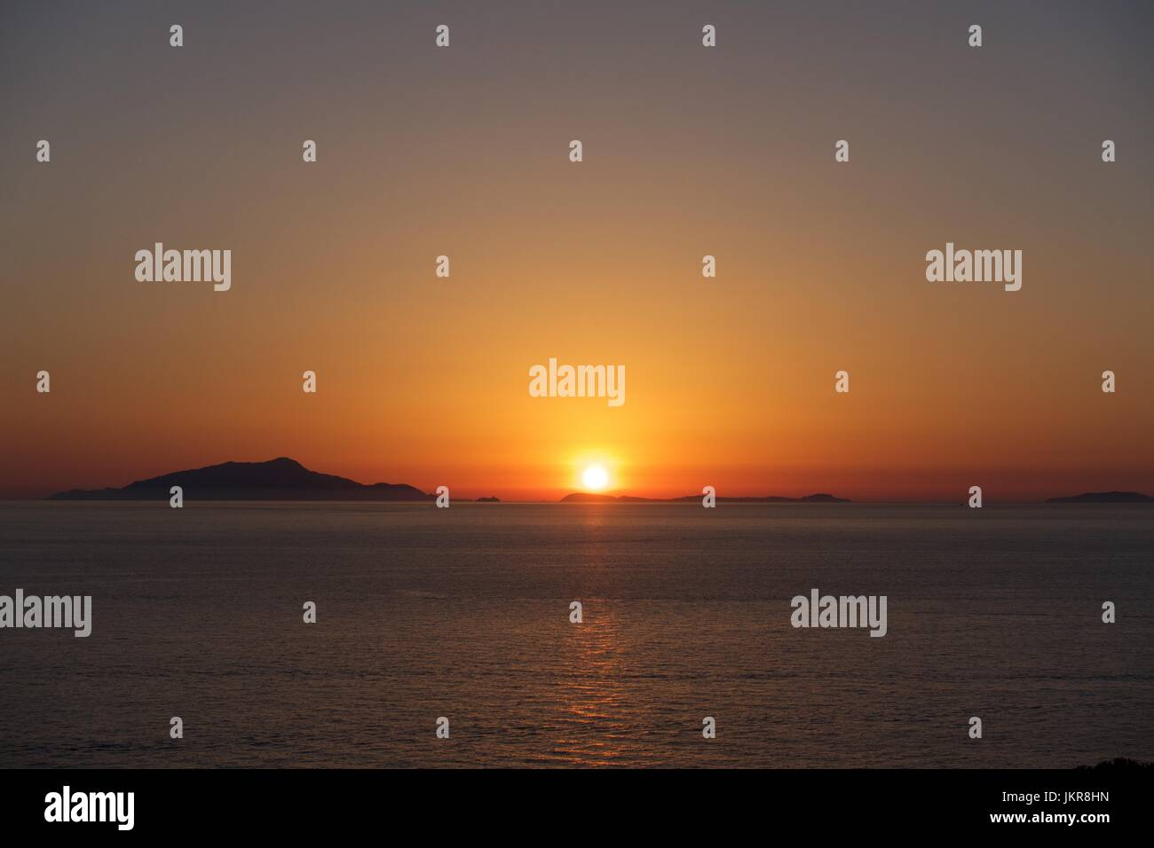 Sunset over Ischia from the Sorrento Peninsula across the Gulf of Naples, Italy - Stock Image