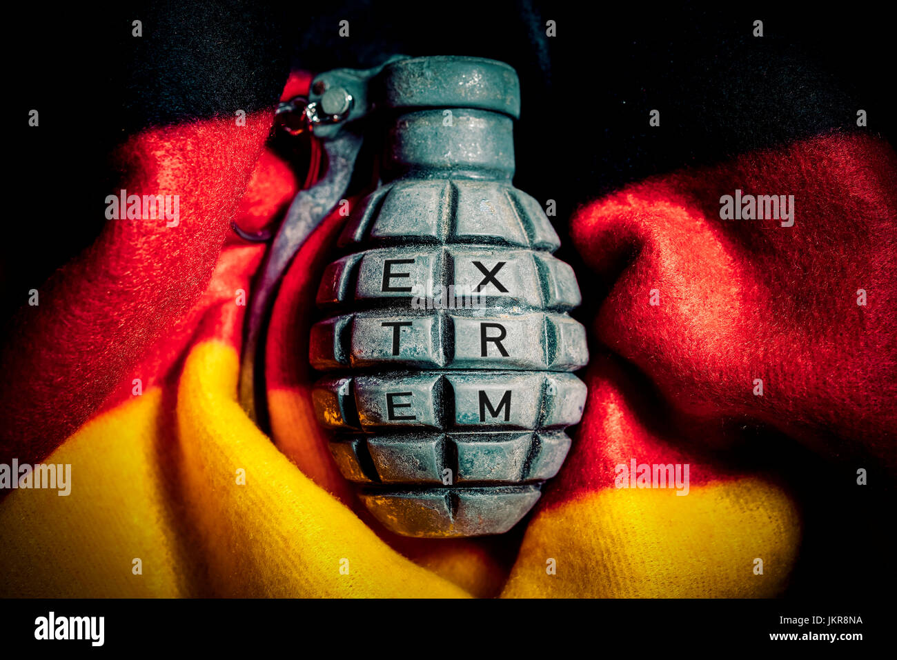 Grenade in Germany flag, extremism in Germany, Handgranate in Deutschlandfahne, Extremismus in Deutschland - Stock Image