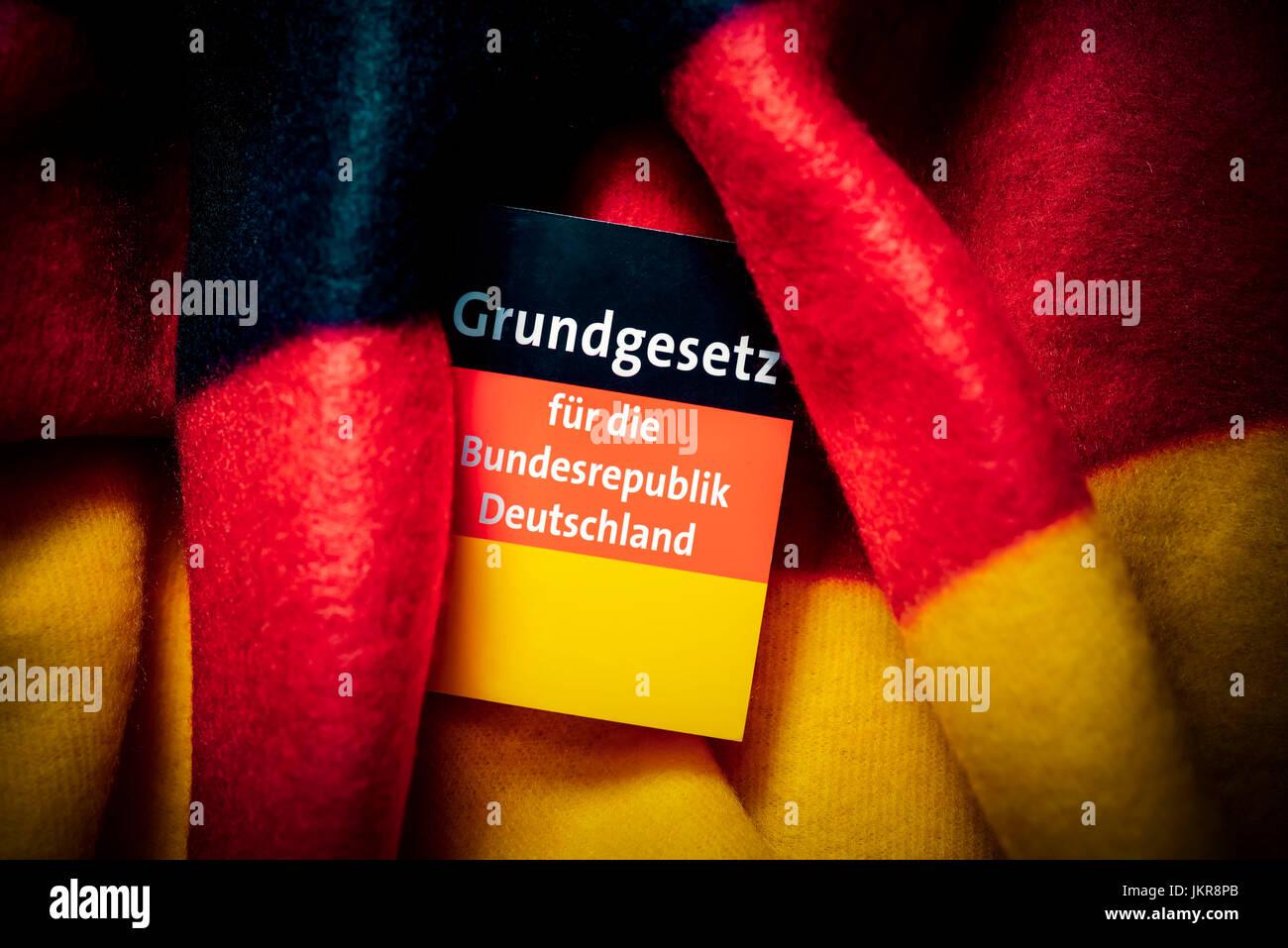 Basic law in Germany flag wound, Grundgesetz in Deutschlandfahne gewickelt - Stock Image