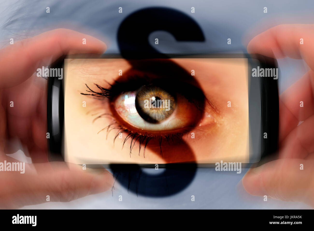 Eye in smartphone camera with section, symbolic photo punishments for nosy parkers, Auge in Smartphone-Kamera mit Stock Photo