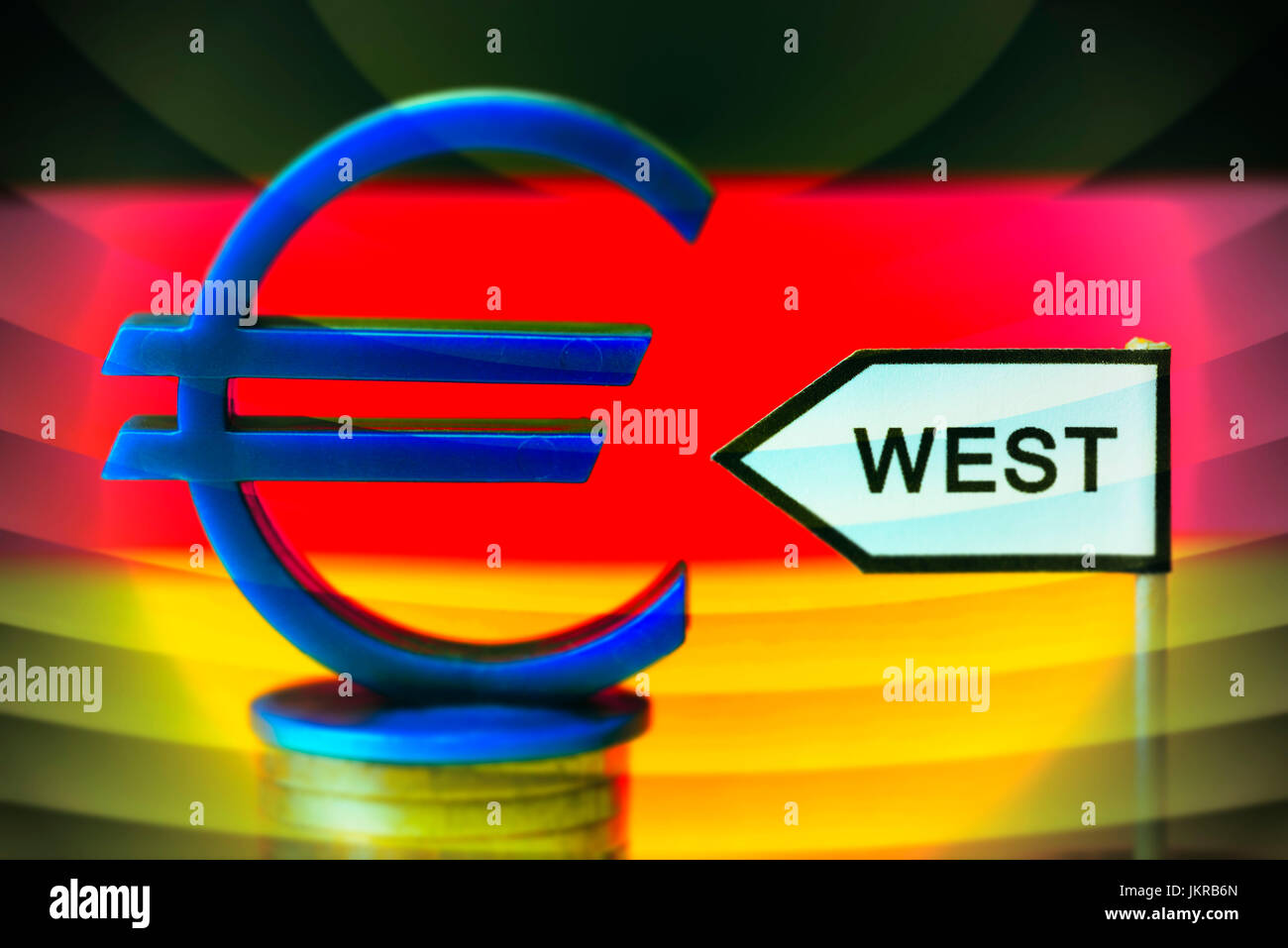 Signpost west and eurosign, unequal salaries in west country and Eastern Germany, Wegweiser West und Eurozeichen, - Stock Image