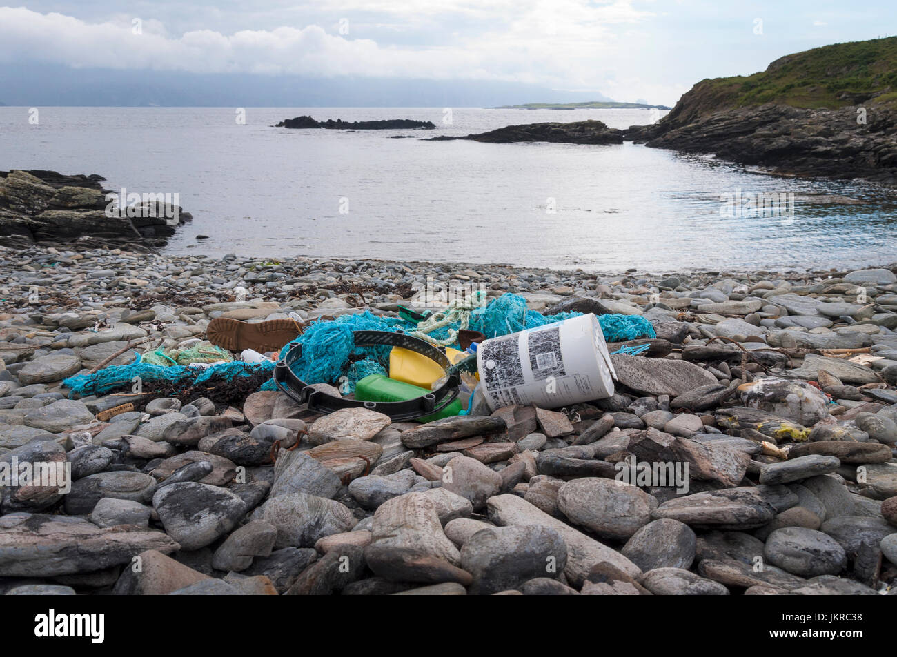 A tangled mass of plastic waste and fishing nets washed up on the shore near Rosbeg, County Donegal, Ireland - Stock Image