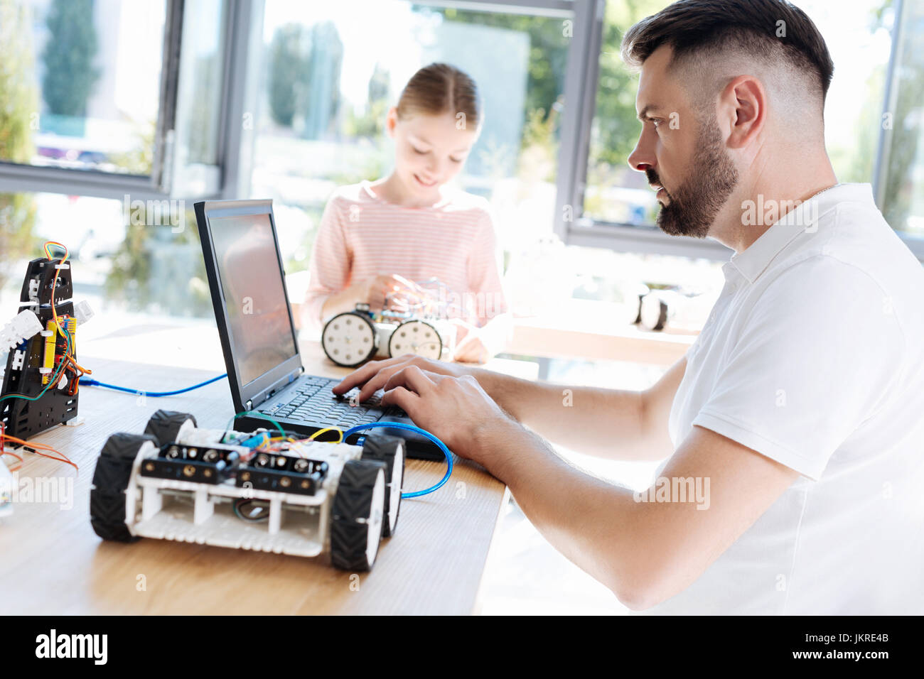 Robotics Teacher Researching For New Project Ideas Stock Photo