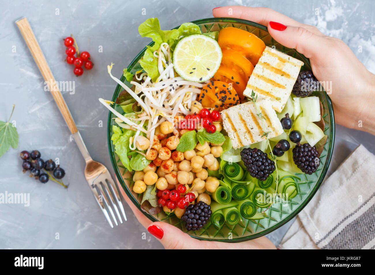 Healthy vegan lunch - buddha bowl of vegetables, chickpeas and tofu. - Stock Image