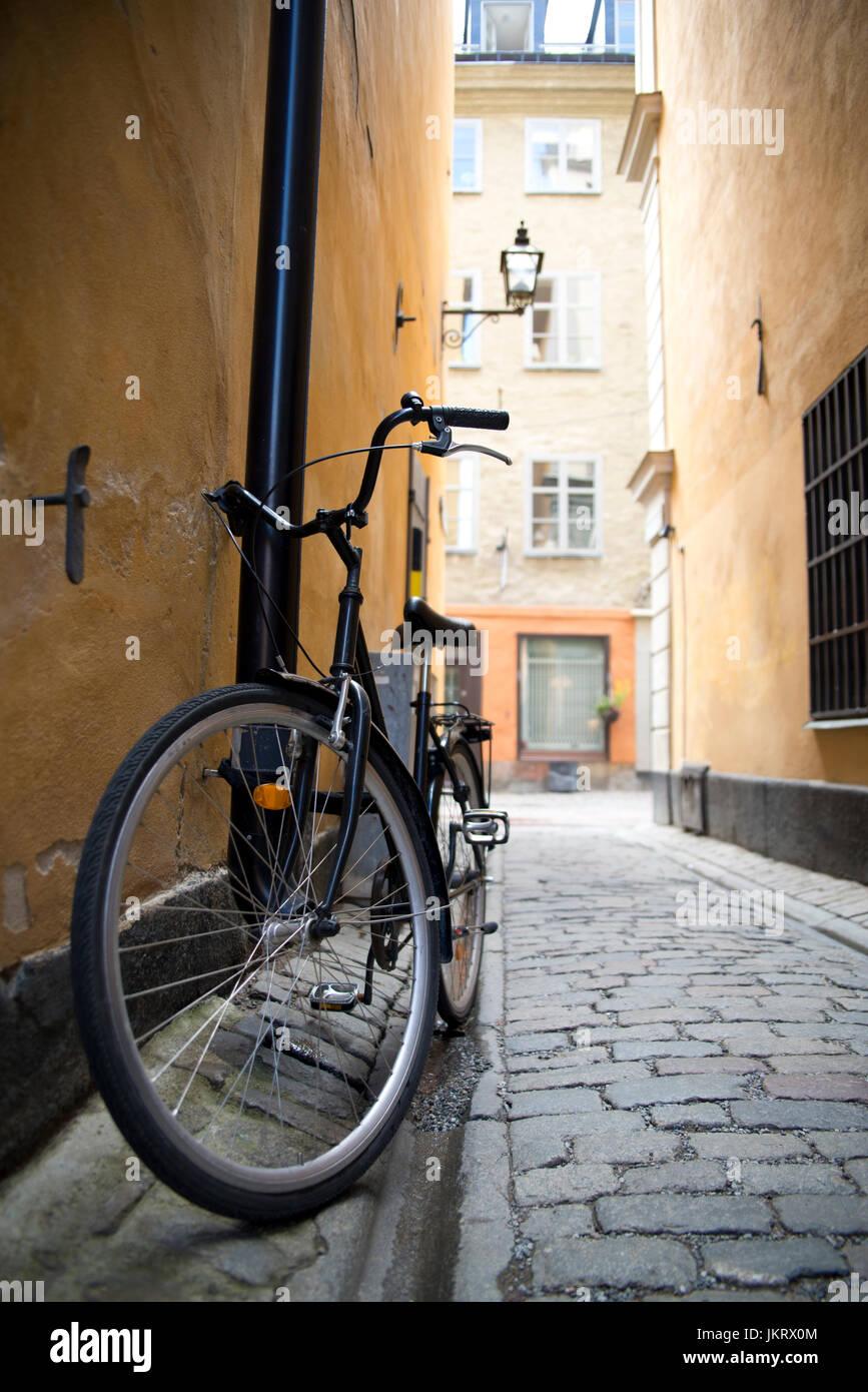 vintage retro bike parked on old cobbled alley, stockholm sweden Stock Photo