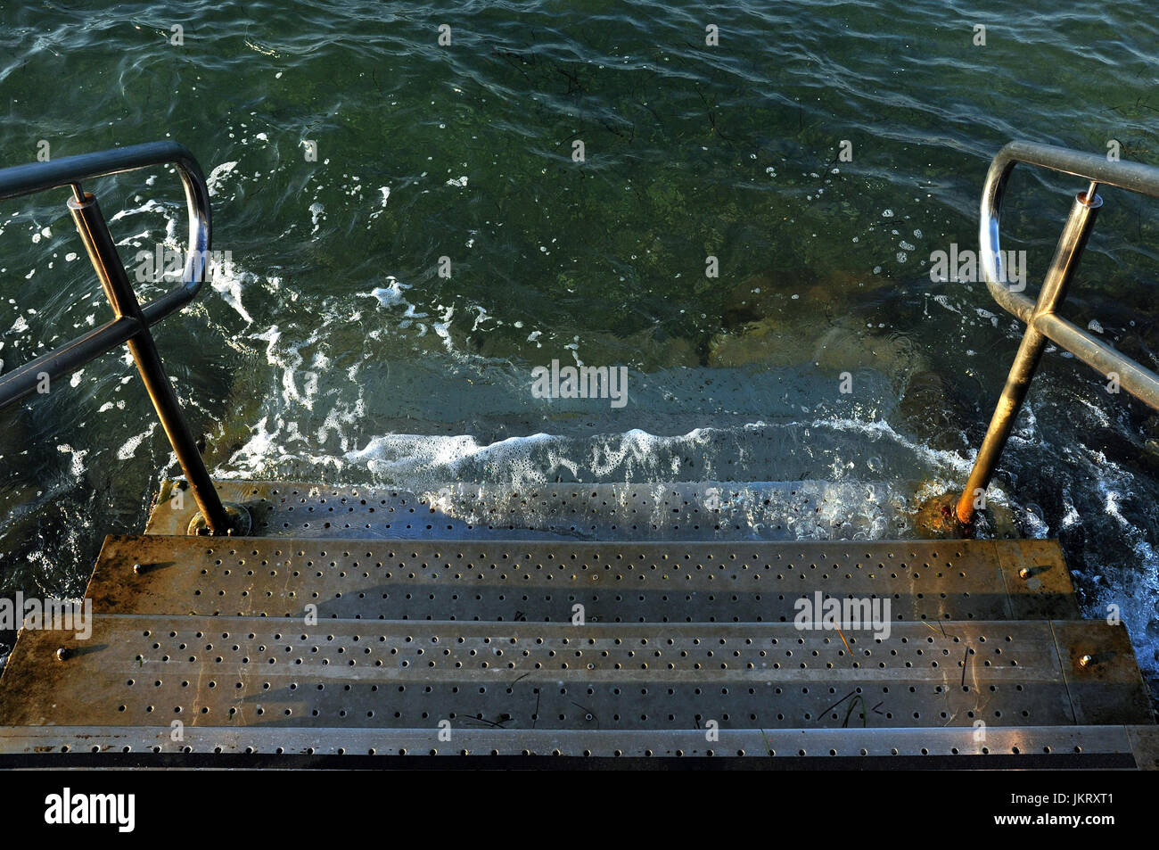 Stairs with handles into the sea, stairway into water, sea stairs Stock Photo