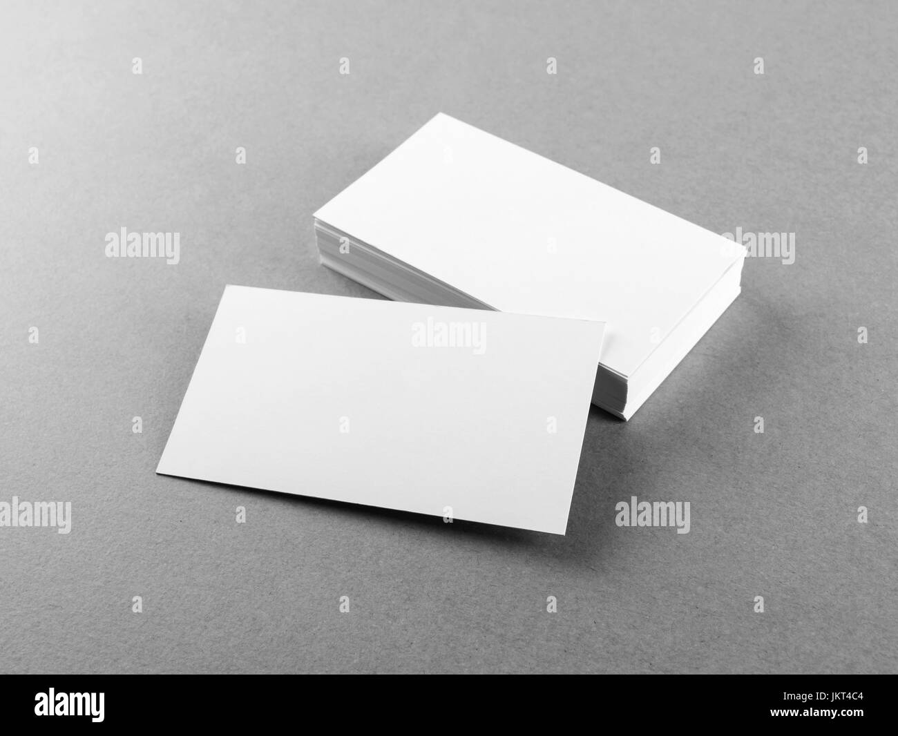 Photo of blank business cards on gray paper background template for photo of blank business cards on gray paper background template for branding identity mockup for id studio shot reheart Gallery