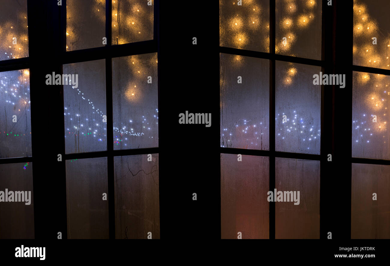 Christmas lights through a window Stock Photo