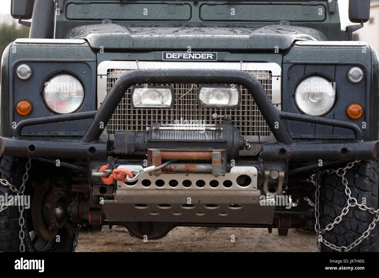 Closeup Of Land Rover With Sump Guard And Snow Chains Jkth G
