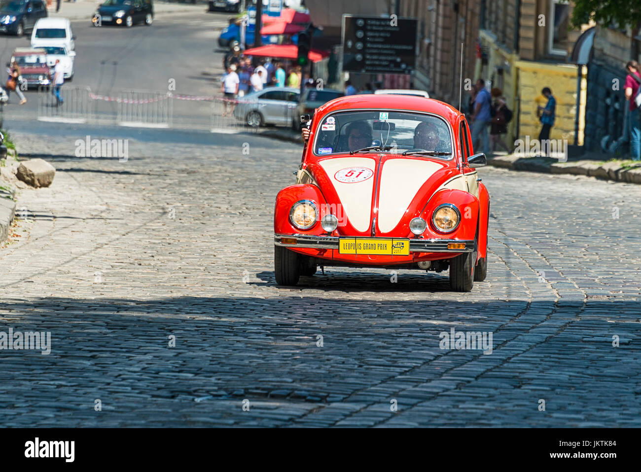 Lviv, Ukraine - June 4, 2017: Old retro car Volkswagen KAFER with its owner and au unknown passenger taking participation - Stock Image