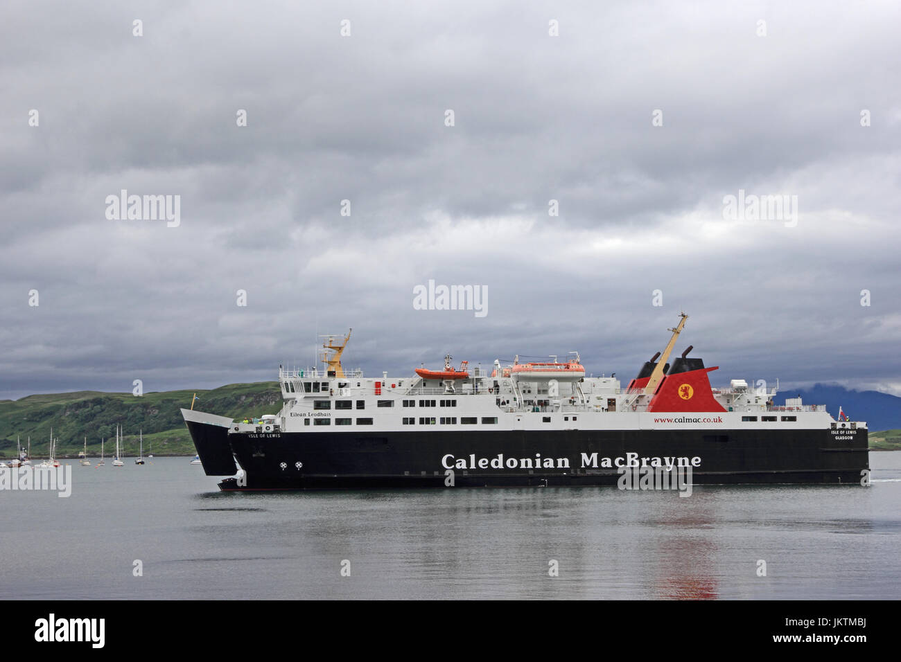Caledonian MacBrayne ferry Isle of Lewis (Eilean Leodhais) entering harbour of Oban, with bow door opening. - Stock Image