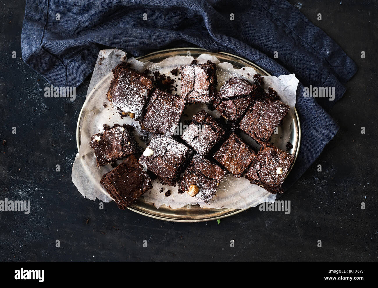 Dark chocolate and walnut brownie squares on a silver tray - Stock Image