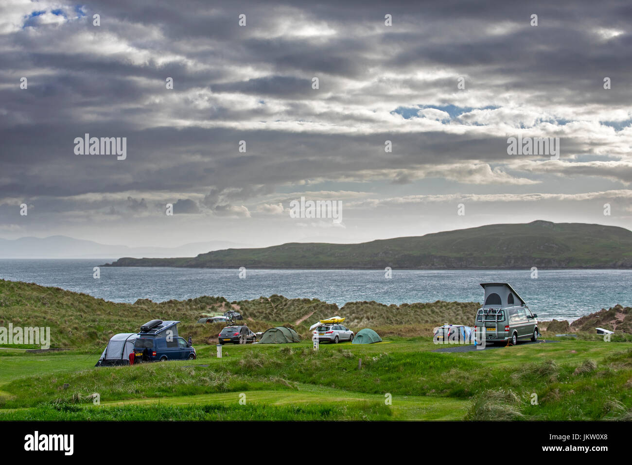 Campervans and tents on campsite along Loch Gairloch, Wester Ross, North-West Scottish Highlands, Scotland, UK - Stock Image