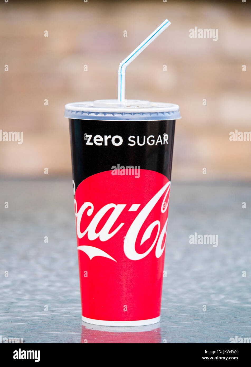 Cup of Coca Cola with Straw, - Stock Image