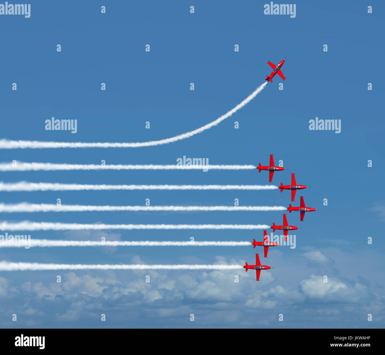 Charting a different path business concept as an independent free thinker idea with air show jet airplanes in an - Stock Image