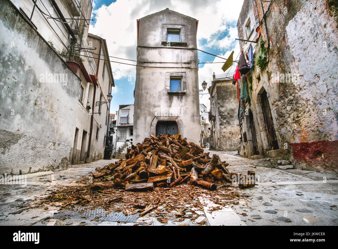 domestic heating firewood old in south italy village Vico del Gargano in Apulia - Stock Image