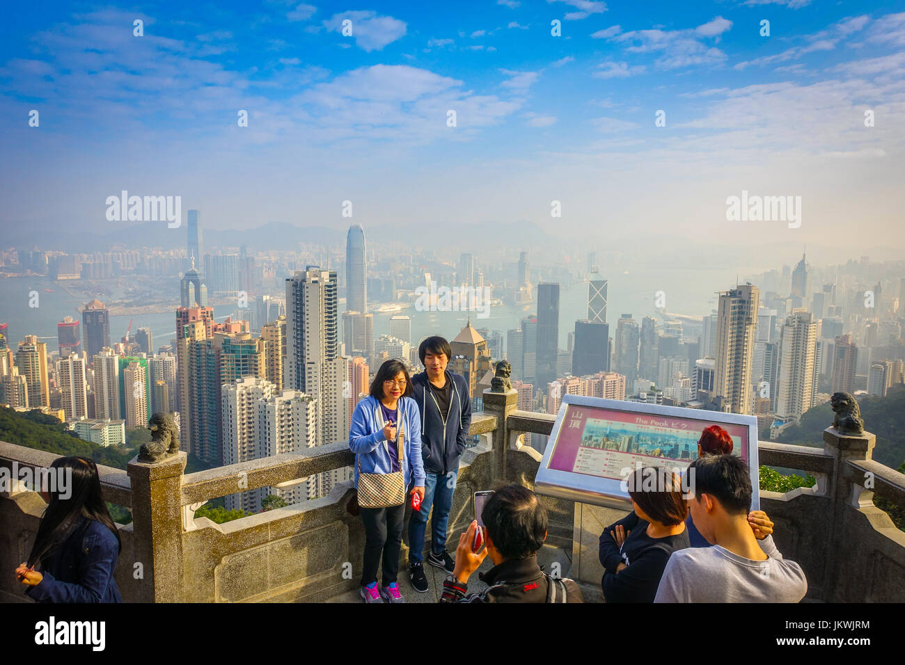 HONG KONG, CHINA - JANUARY 22, 2017: Unidentified people taking pictures from Victoria Peak to the city of Hong - Stock Image