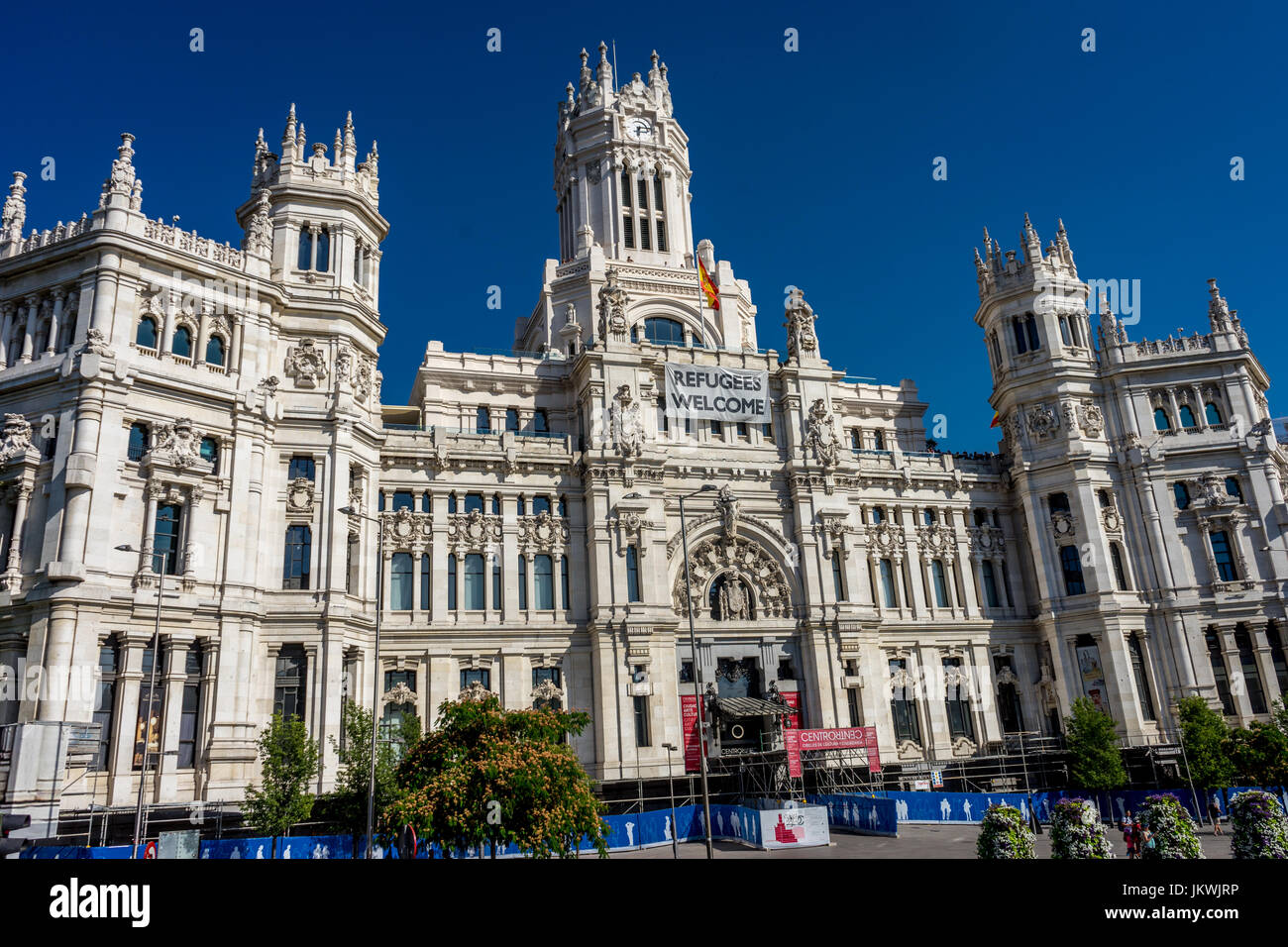 Madrid, Spain - June 17 : The Madrid city hall on June 17, 2017. A welcome refugees banner is displayed on the city - Stock Image