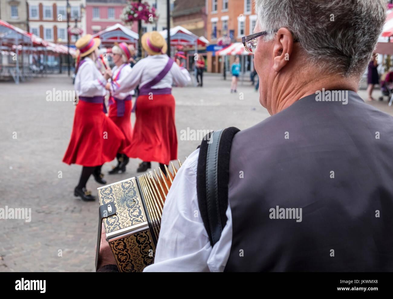 Rivington Morris perform traditional Morris dancing in the market square, Newark Upon Trent, Nottinghamshire, UK - Stock Image