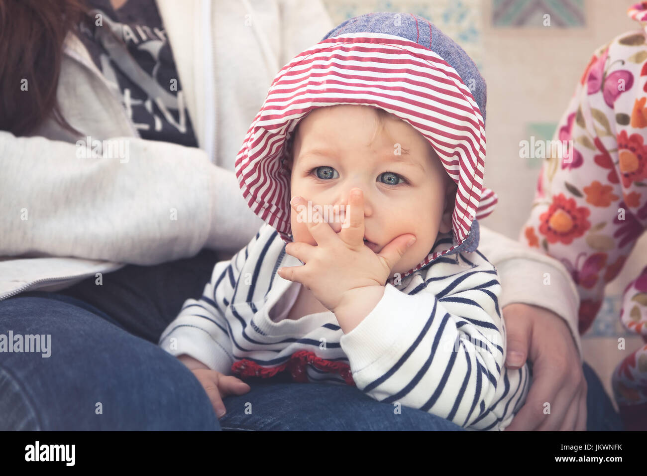 Child with surprised facial expression symbolizing unbelievable expression - Stock Image