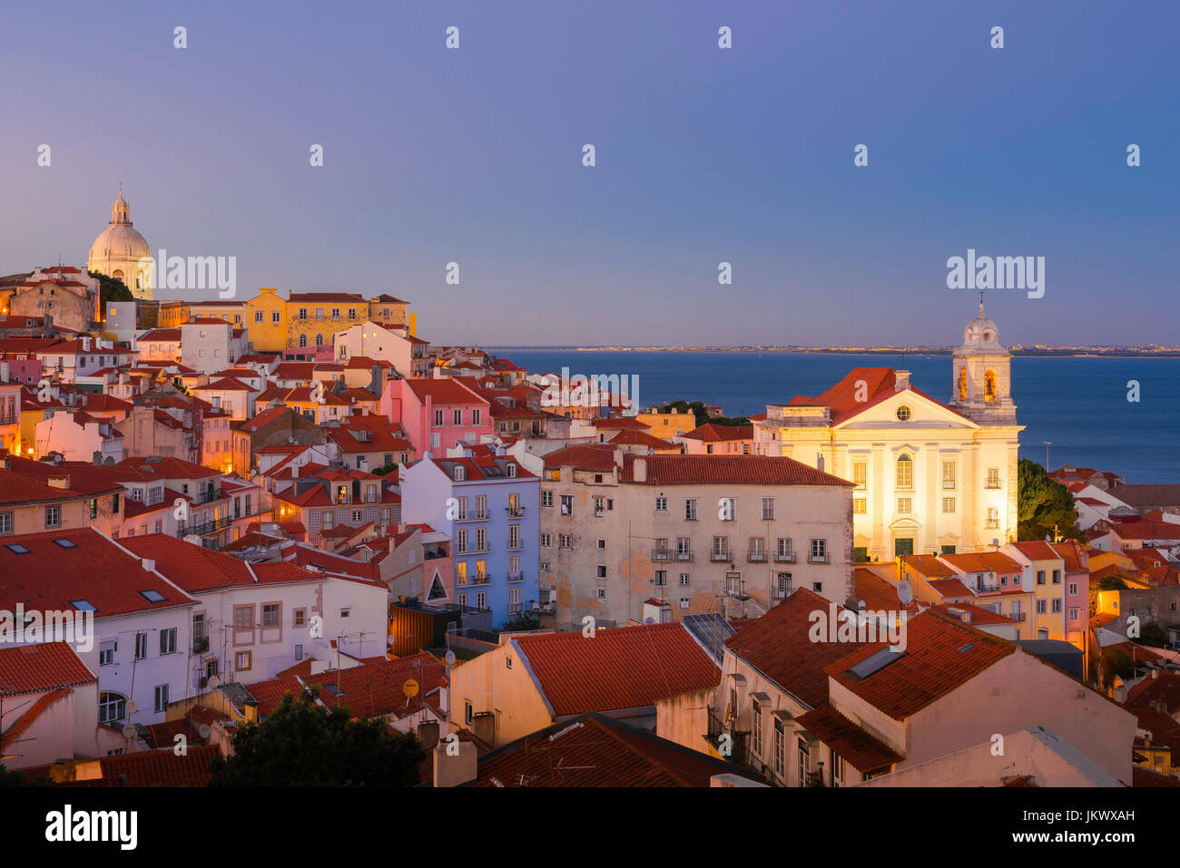 Lisbon Portugal cityscape, view of the Alfama skyline at night with the Sao Estevao church illuminated, Lisbon Portugal. - Stock Image