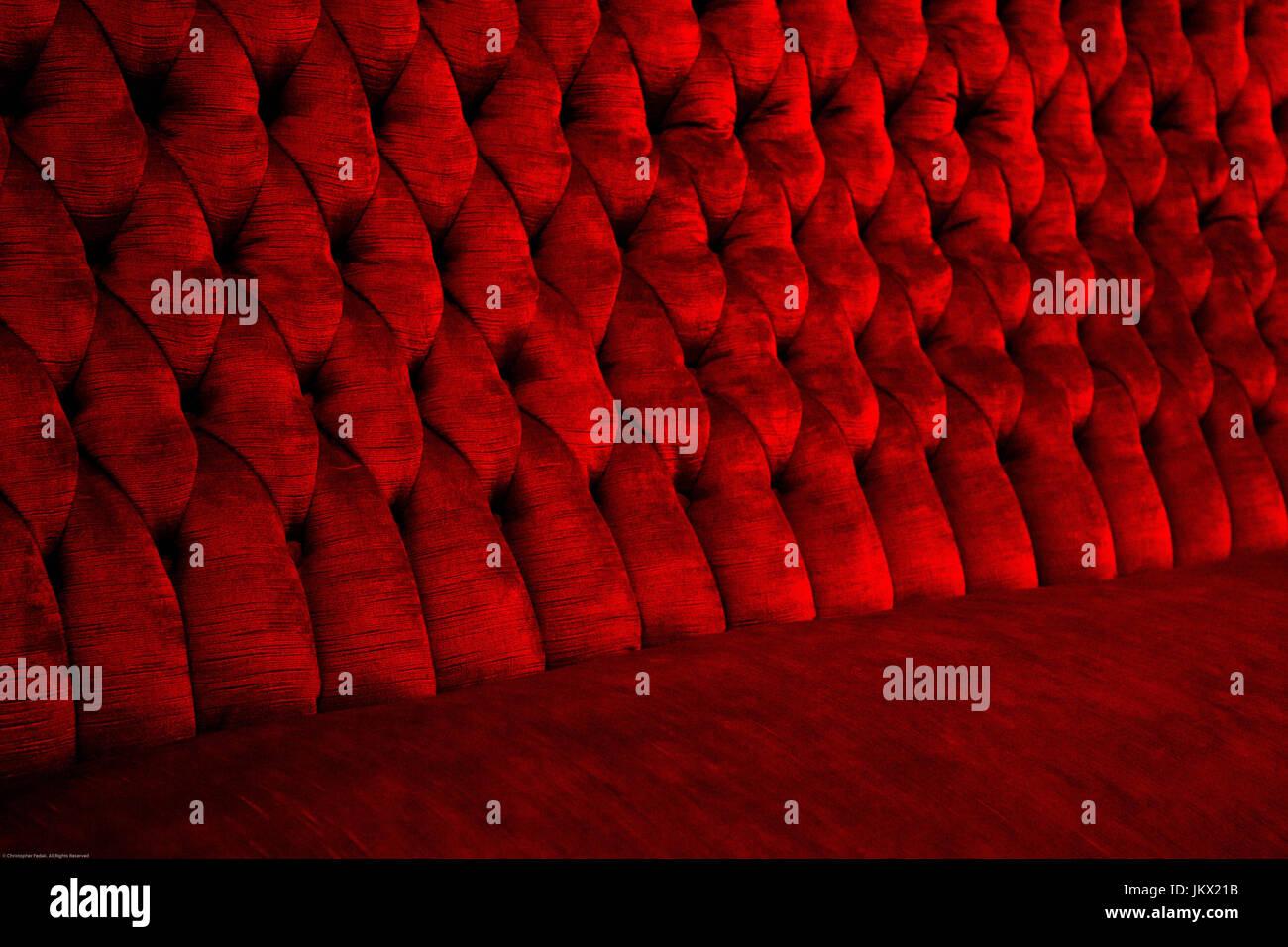 soft deep red sofa close up - Stock Image