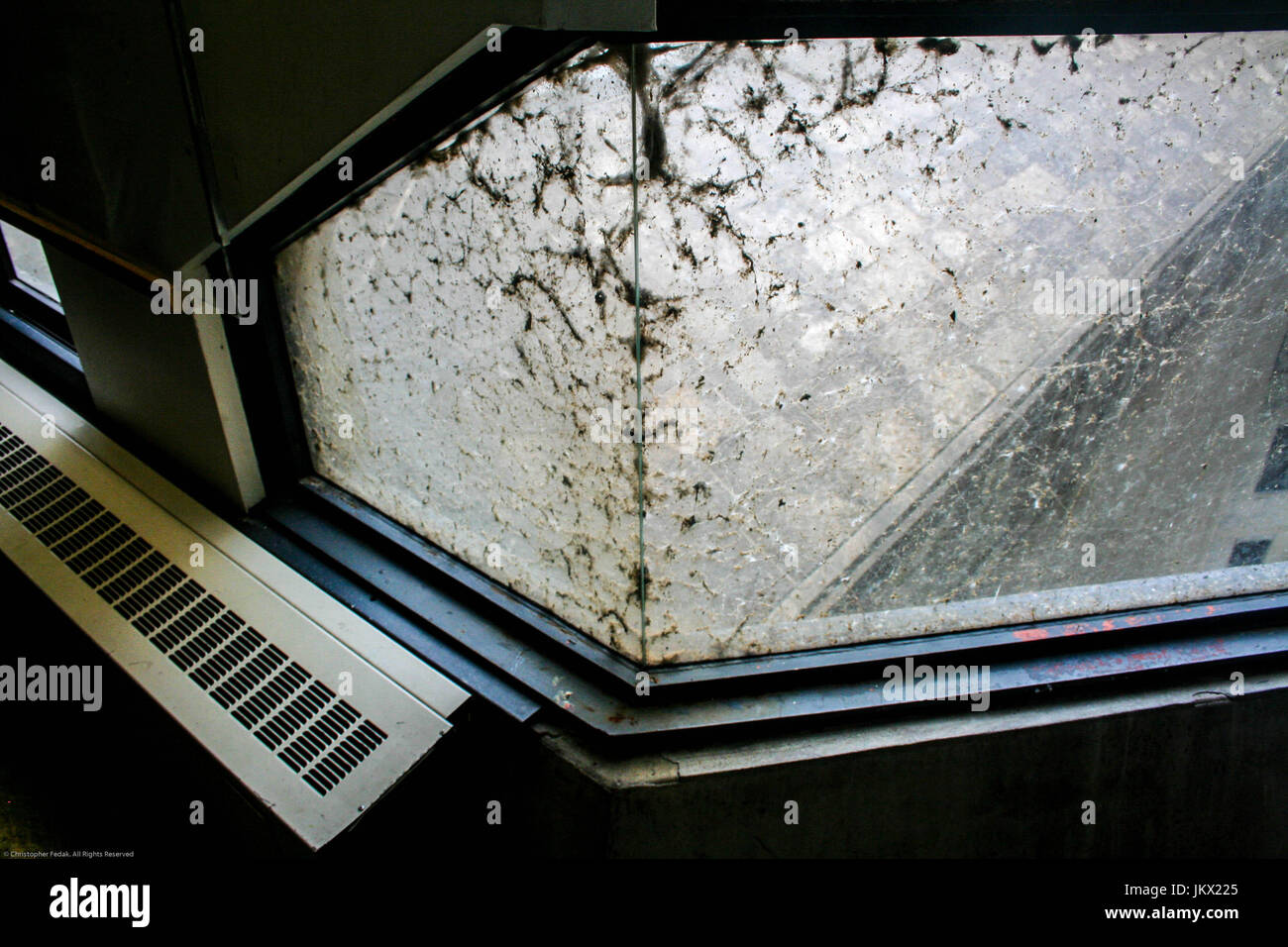 accumulated dust on a window needs cleaned badly. - Stock Image