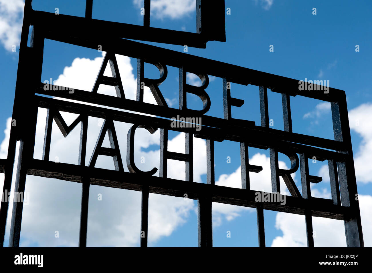 Arbeit Macht Frei iron gate at the entrance to Sachsenhausen Concentration Camp, Oranienburg, Germany - Stock Image
