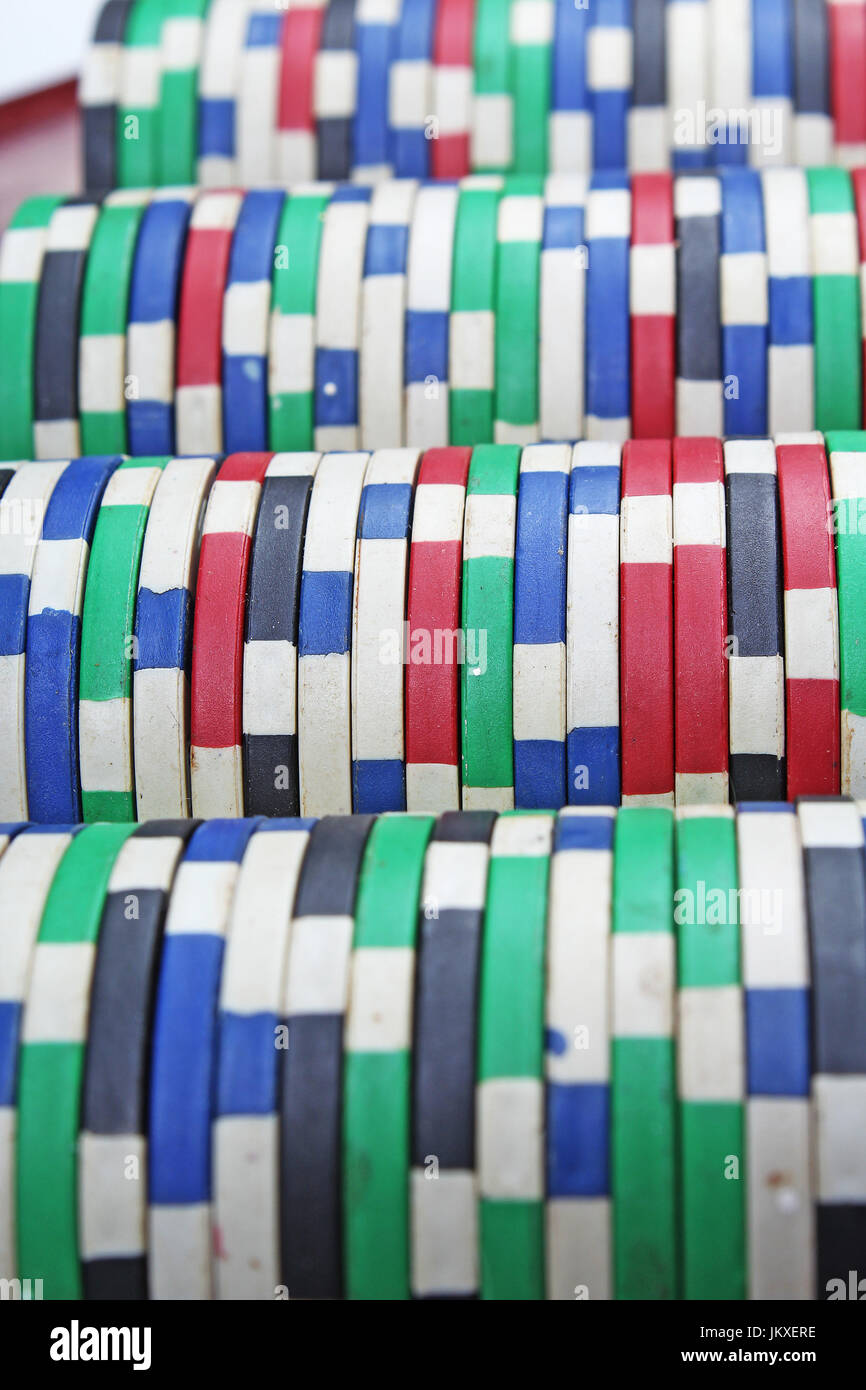 Casino poker money chips texture. Stack of poker chips as background. - Stock Image