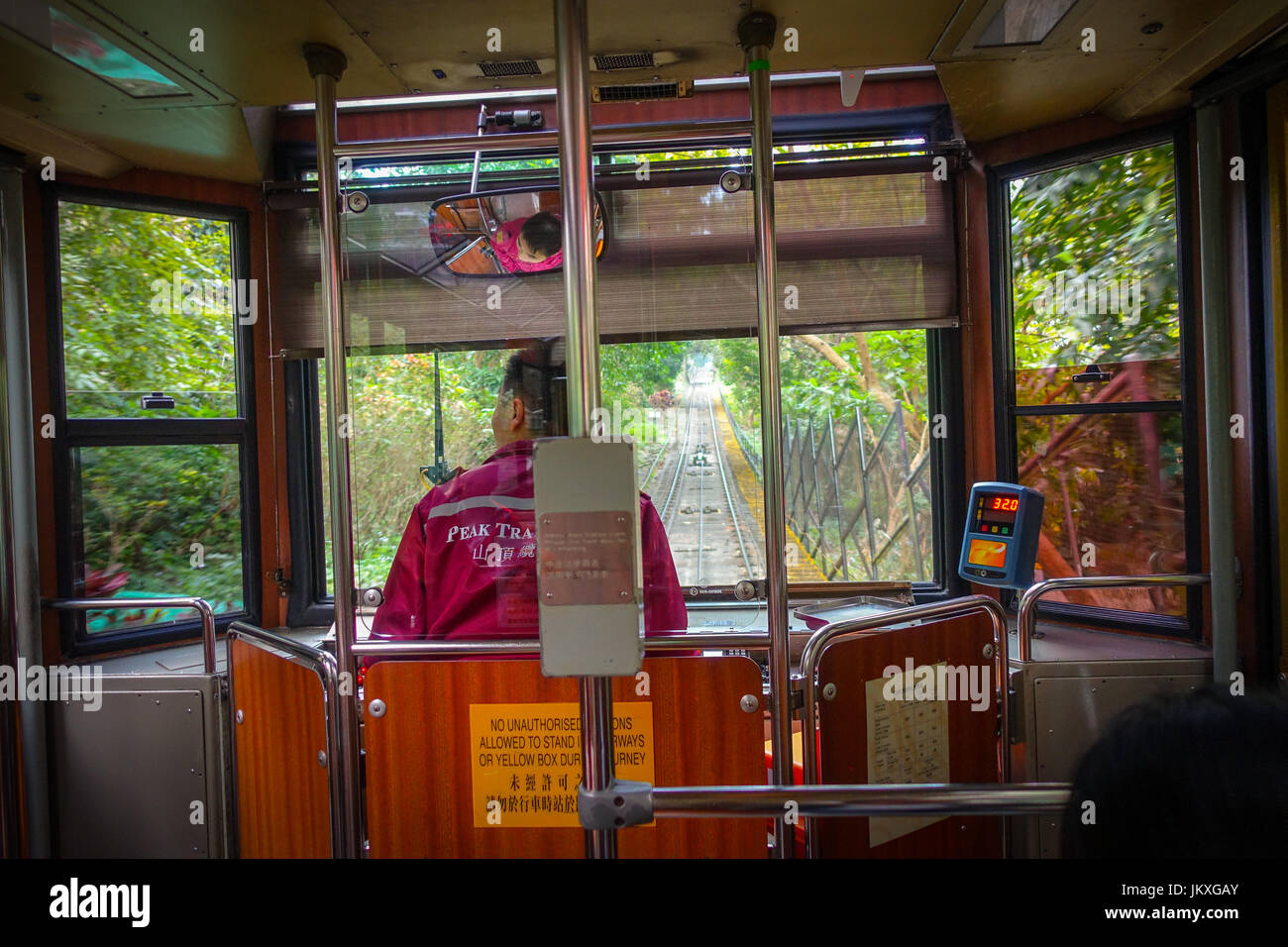 HONG KONG, CHINA - JANUARY 22, 2017: Bus driver inside of a Tram car, drives at Peak Tram, is a funicular railway - Stock Image