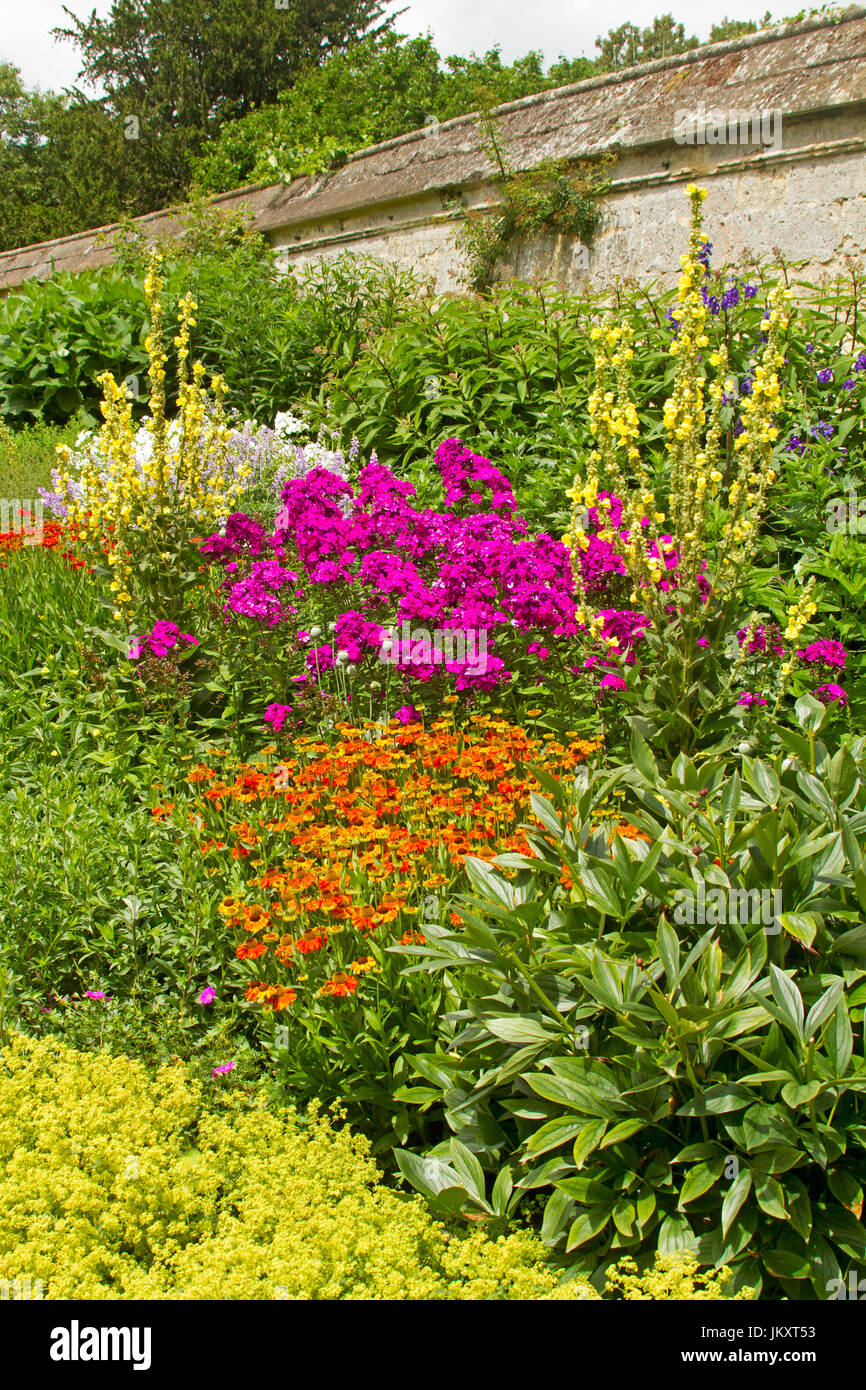 Cottage Garden With Herbaceous Border Of Summer Flowering Perennials