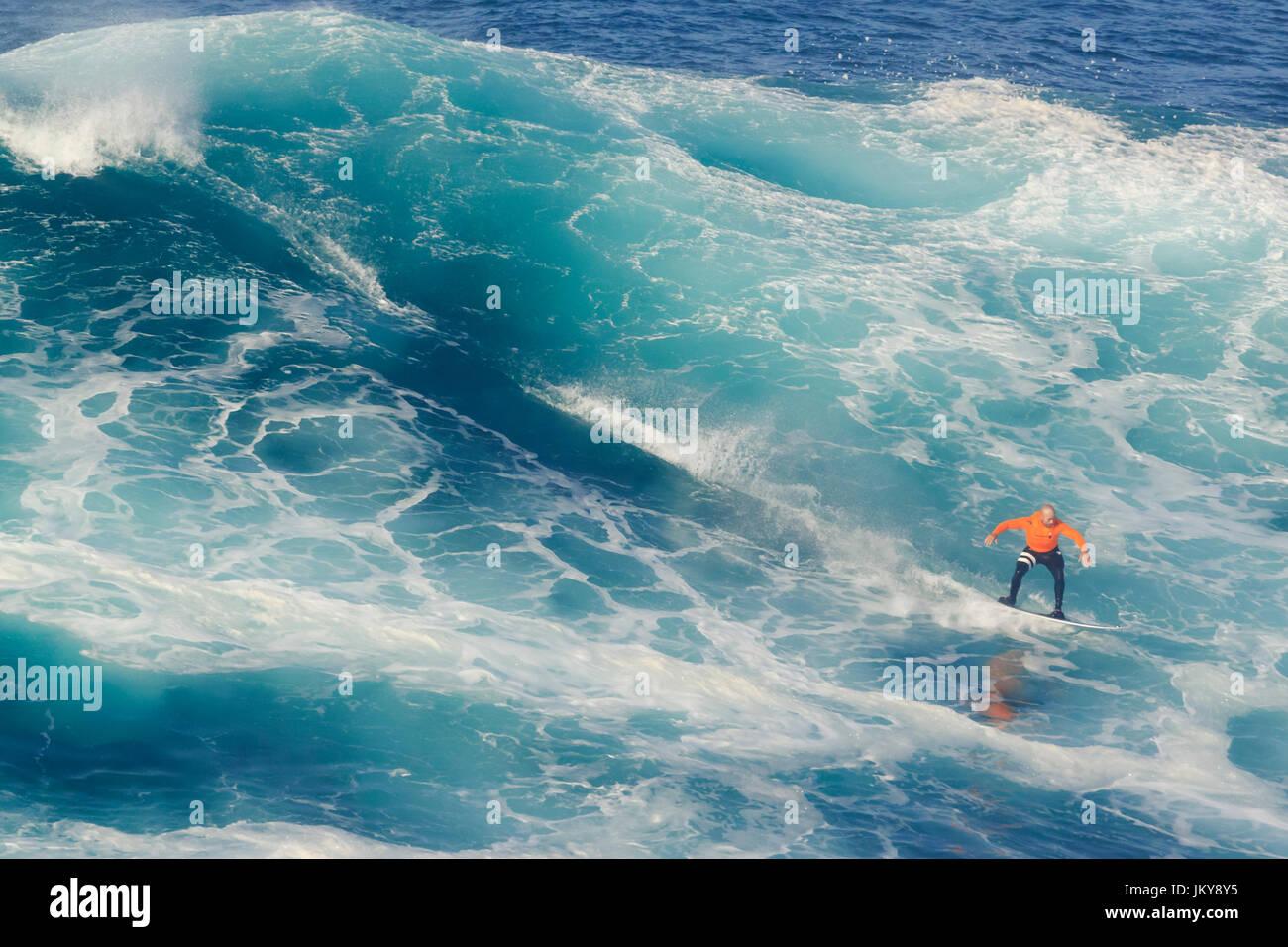 Big wave surfing event. The biggest surfing waves in the world, at Praia do Norte beach, Nazare, Portugal, popularized by Garrett MacNamara Stock Photo