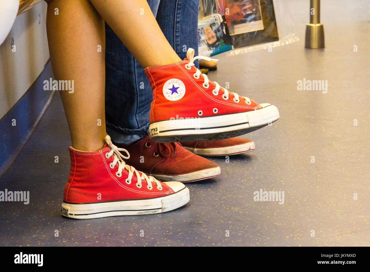 417741fad55c Young girl wearing pair of Converse All Star shoes Stock Photo ...