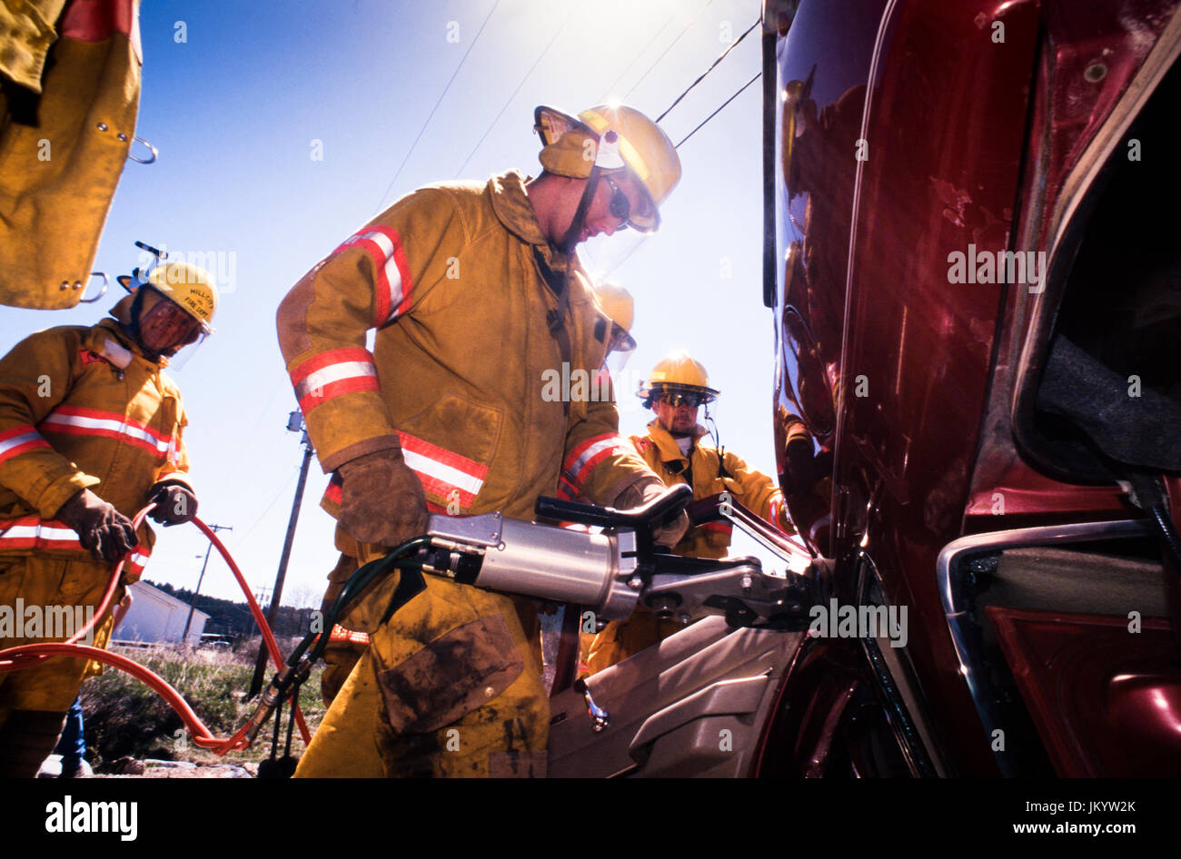 South Dakota firefighters take part in victim extrication training during a motor vehicle crash scenario using hydraulic - Stock Image