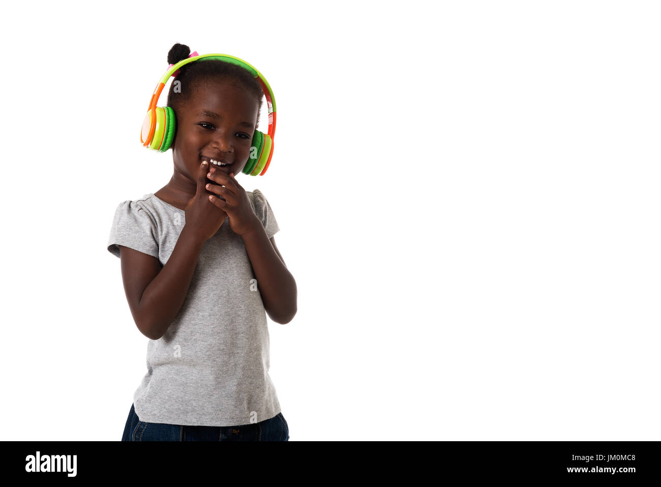 Music and technology concept.African happy little girl with headphones on white background.Copyspace - Stock Image