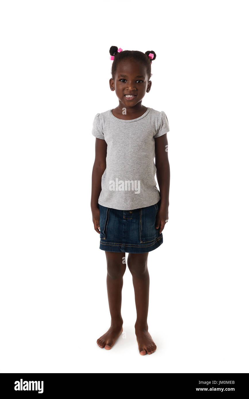 Cute African  little girl standing barefoot ,looking to the camera on white background - Stock Image