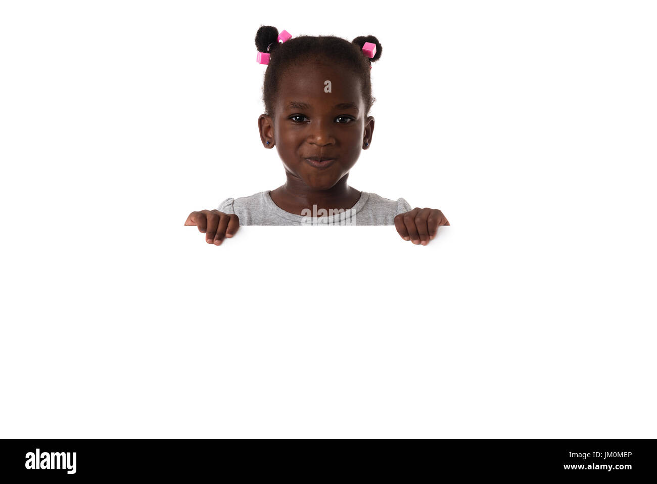 Portrait of little African girl in studio with white board.Isolated. Copyspace - Stock Image