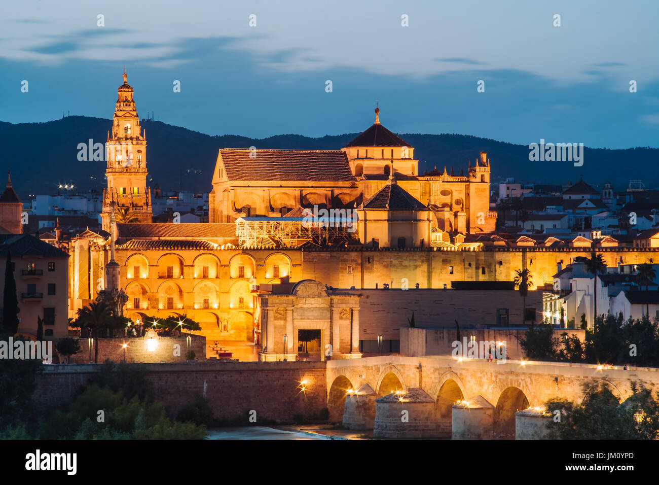 Sunset over the amazing Mezquita, ancient mosque in Cordoba, Spain - Stock Image