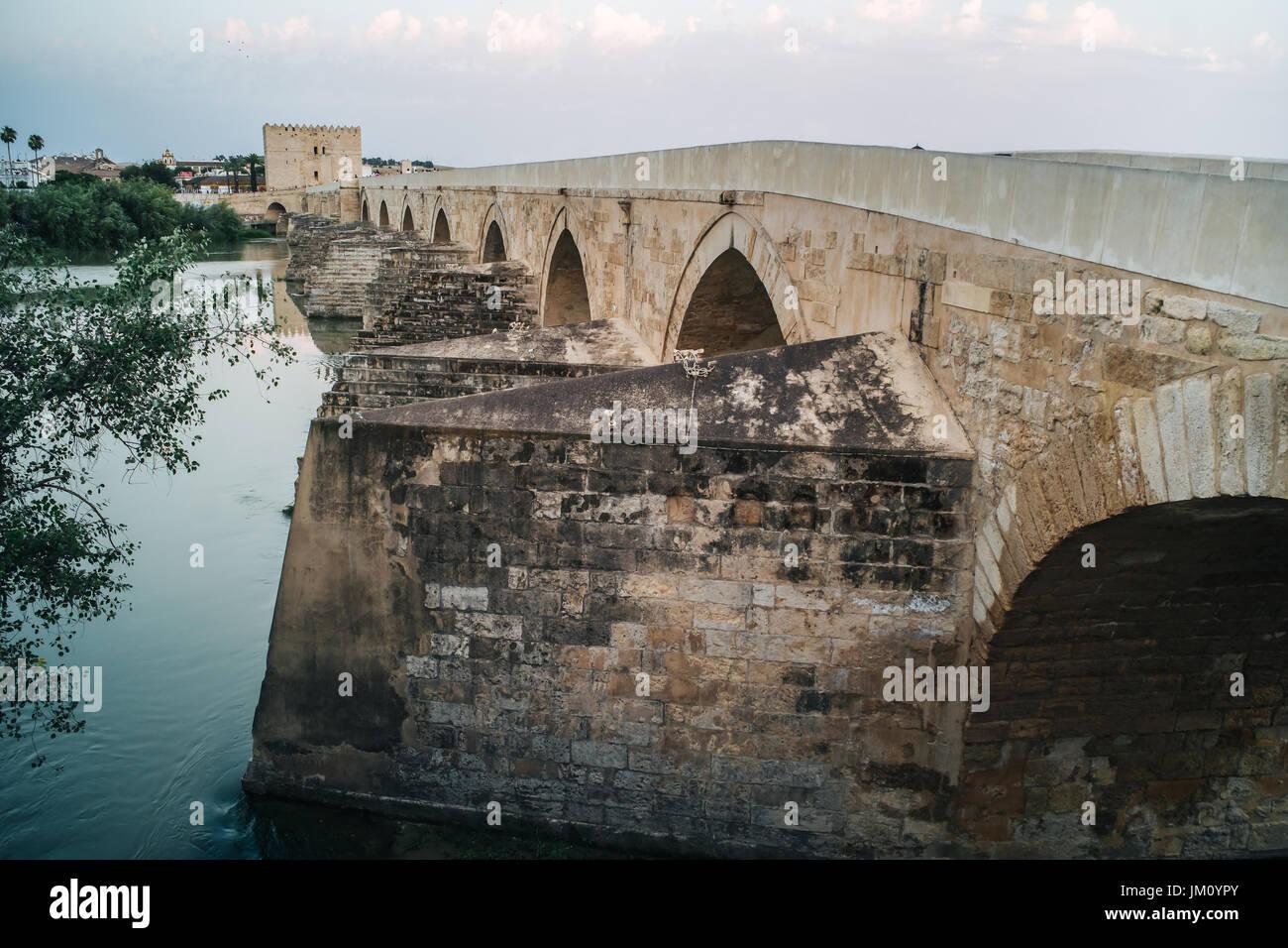 The wonderful Roman bridge and the Mezquita in Cordoba, Spain - Stock Image