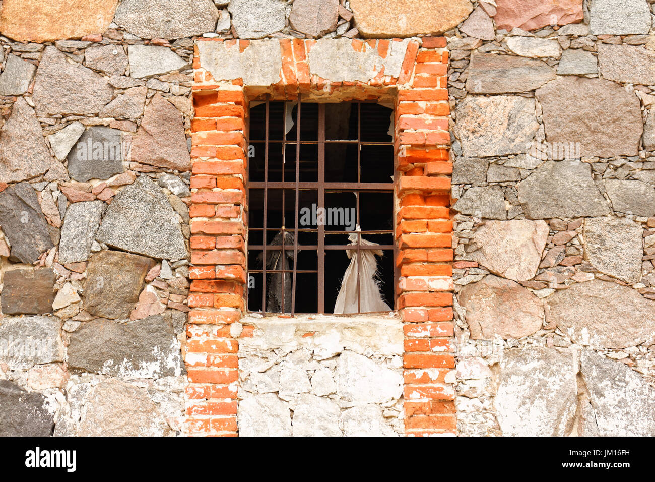Old stone and brick wall with window - Stock Image