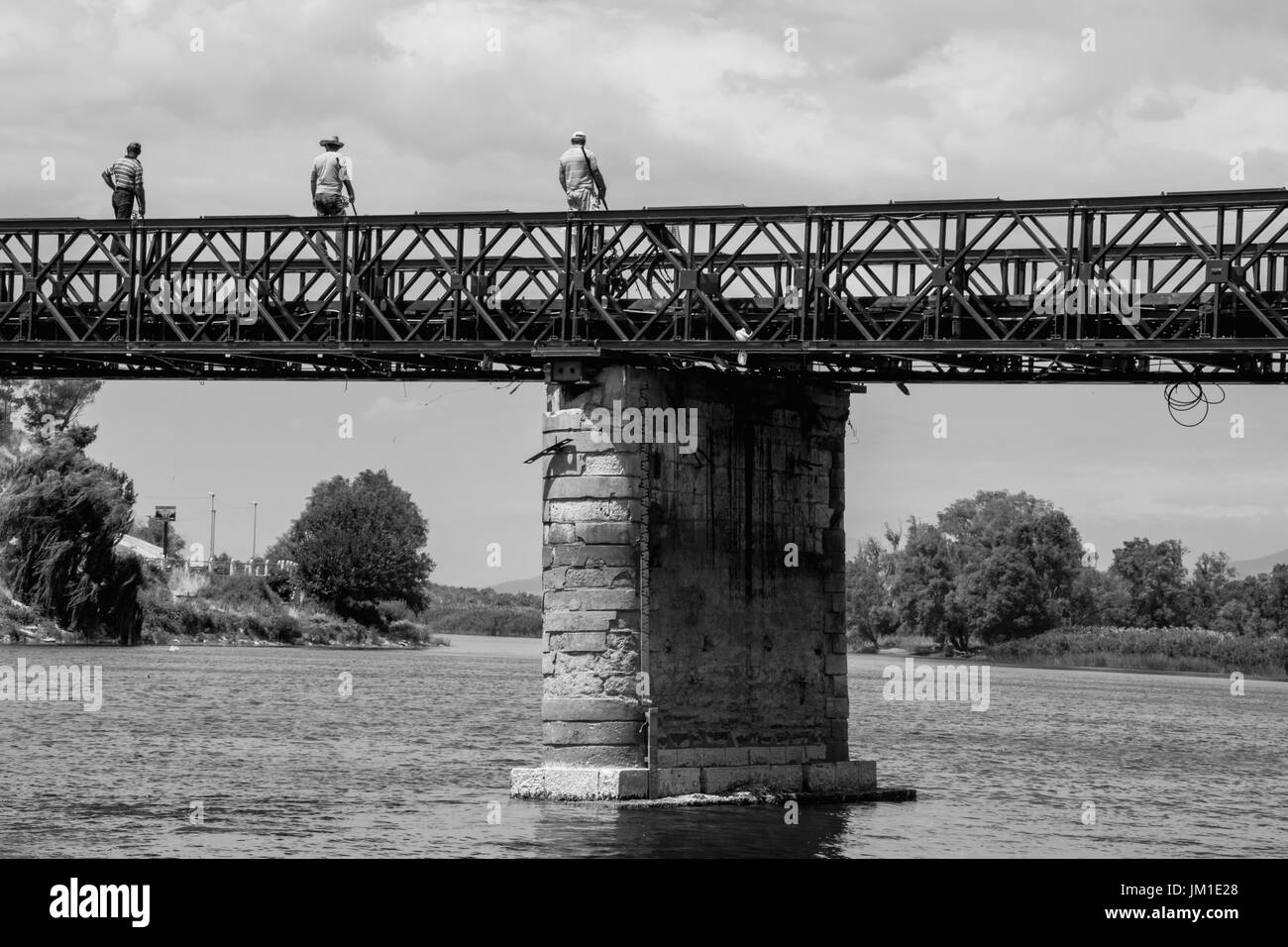 Three fishermen above the bridge - Stock Image
