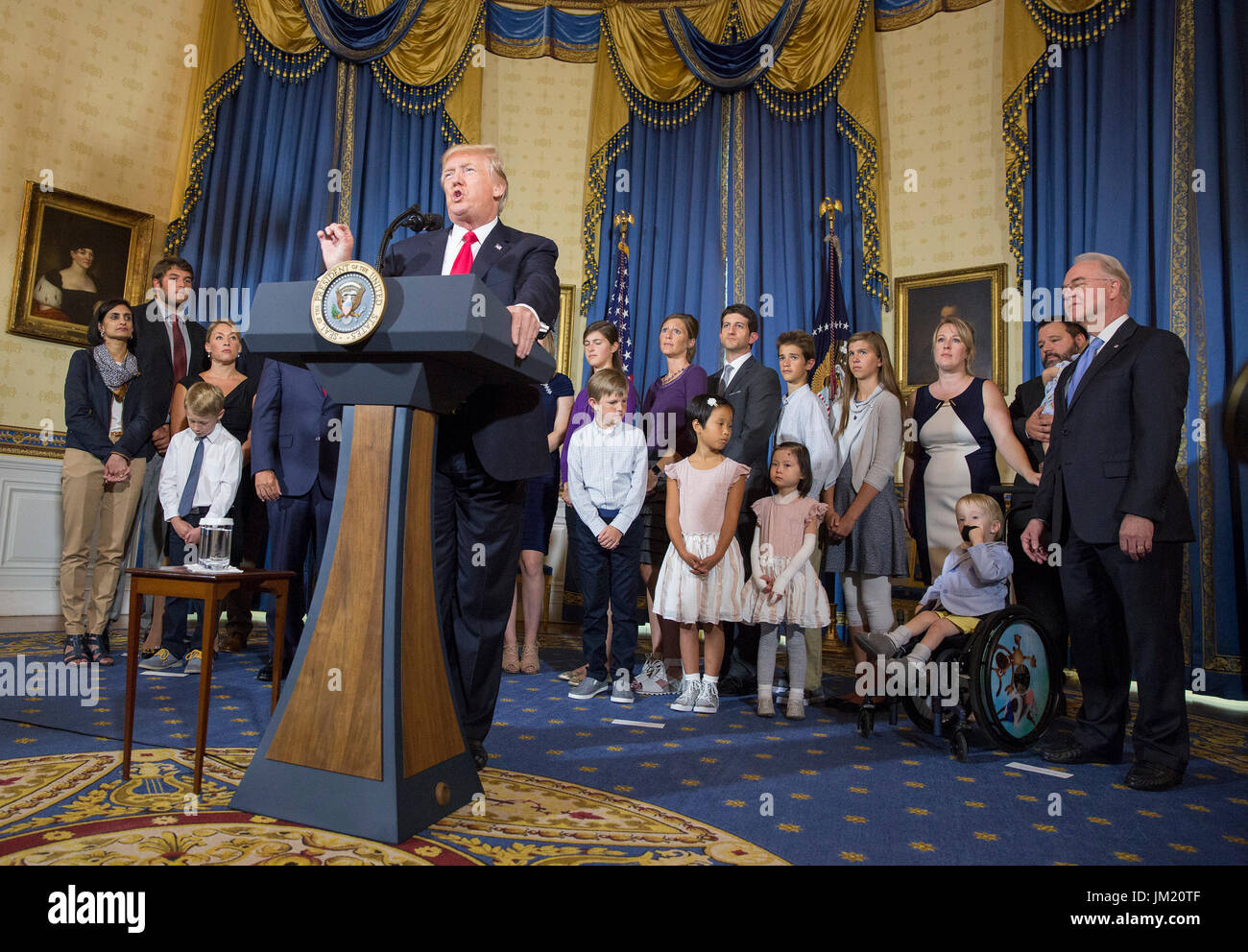 United States President Donald J. Trump makes a statement on health care while standing with 'victims of Obamacare' at The White House in Washington, DC, July 24, 2017. Credit: Chris Kleponis/CNP /MediaPunch - Stock Image