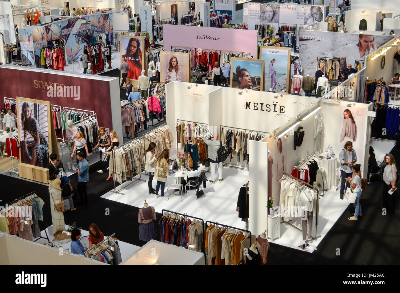 Clothing stands at Pure London, Olympia, London, UK. Pure London, the UK's leading trade fashion exhibition opened its doors 23-25th July 2017, featuring two halls of trade stands from leading fashion and accessories designers, lectures from industry experts, and fashion shows on two different catwalks throughout each day. Fashion buyers were out in force to see the new season's collections. 25th July 2017. Credit: Antony Nettle/Alamy Live News - Stock Image